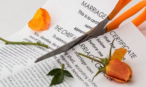 Marriage License being cut by scissors. Alternative Divorce Resolutions (ADR)